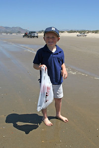Christopher collecting sand dollars while going for a long walk (about four miles round trip) between Pismo State Beach's North Beach and Oceano Lagoon campgrounds.