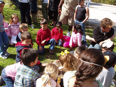 The kids getting up close and personal with a tortoise during Alanna and Jaison's birthday party at the Santa Barbara Zoo.