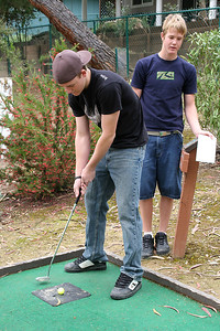 Ryan, with Grady looking on, playing a round of miniature golf while visiting the Roth Lake House, which is located on Lake Nacimiento in the Oak Shores gated community.