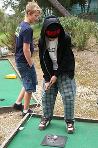 Nathan playing a round of miniature golf while visiting the Roth Lake House, which is located on Lake Nacimiento in the Oak Shores gated community.