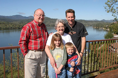 Grady and Mary Clare Kane with their son, Patrick, and his children, Sydney and Christopher. The picture was taken on the deck of the Roth Lake House, which is located on Lake Nacimiento in the Oak Shores gated community.