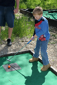 Christopher getting in a round of miniature golf while visiting the Roth Lake House, which is located on Lake Nacimiento in the Oak Shores gated community.
