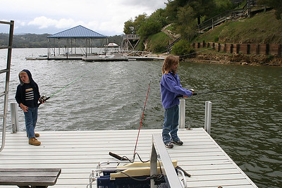 Christopher and Sydney fishing off of a dock near the Roth Lake House, which is located on Lake Nacimiento in the Oak Shores gated community. They didn't catch anything, but they had fun trying.