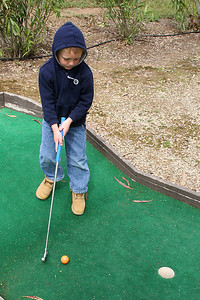 Christopher playing a round of miniature golf while visiting the Roth Lake House, which is located on Lake Nacimiento in the Oak Shores gated community.