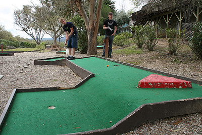 Grady, with Ryan looking on, getting in a round of miniature golf while visiting the Roth Lake House, which is located on Lake Nacimiento in the Oak Shores gated community.