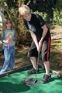 Nathan, with Sydney looking on, playing a round of miniature golf while visiting the Roth Lake House, which is located on Lake Nacimiento in the Oak Shores gated community.