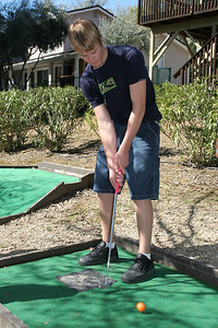 Grady playing a round of miniature golf while visiting the Roth Lake House, which is located on Lake Nacimiento in the Oak Shores gated community.