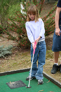 Sydney playing a round of miniature golf while visiting the Roth Lake House, which is located on Lake Nacimiento in the Oak Shores gated community.