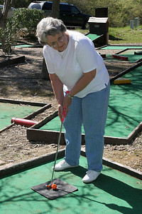 Mary Clare playing a round of miniature golf while visiting the Roth Lake House, which is located on Lake Nacimiento in the Oak Shores gated community.