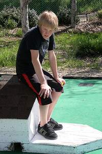Nathan supervising playing during a round of miniature golf while visiting the Roth Lake House, which is located on Lake Nacimiento in the Oak Shores gated community.