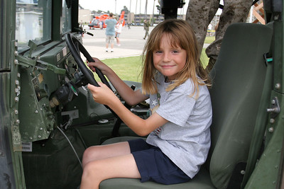 Sydney behind the wheel of a HMMWV at the 2006 Seabee Days
