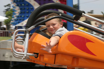 Christopher flying at the Seabee Days carnival