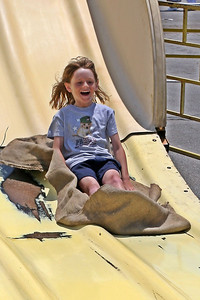 Sydney sliding down the super slide at the Seabee Days carnival