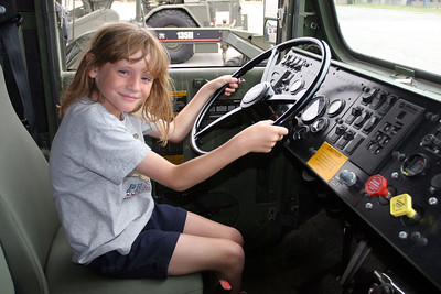 Sydney behind the wheel of a Medium Tactical Vehicle Replacement (MTVR) at the 2006 Seabee Days.