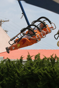 Sydney and Christopher flying on one of the rides during the Seabee Days carnival