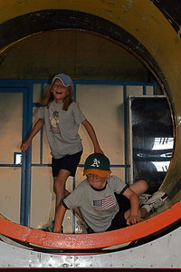 Sydney and Christopher enjoying the fun house at the Seabee Days carnival