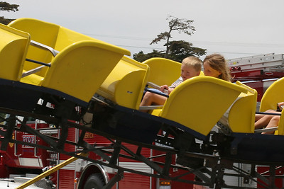 Christopher and Sydney enjoying the roller coaster at the Seabee Days carnival