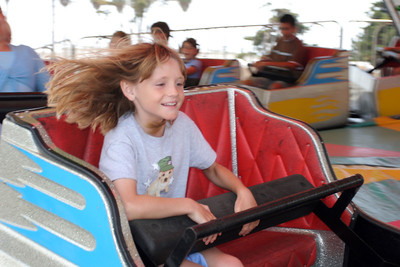Sydney enjoying a fast spinning ride at the Seabee Days carnival