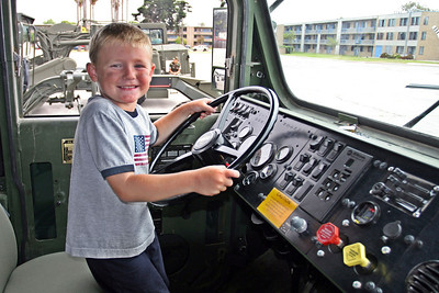 Christopher behind the wheel of a Medium Tactical Vehicle Replacement (MTVR) at the 2006 Seabee Days.