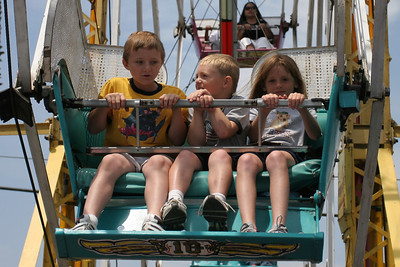 Sydney and Christopher enjoying the ferris wheel at the Seabee Days carnival