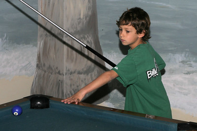 Ethan shooting pool during Sydney's 8th Birthday Party at the Ventura YMCA.