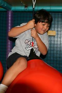 Austin enjoying the jungle gym during Sydney's 8th Birthday Party at the Ventura YMCA.