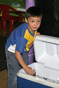 Eli grabbing a drink during Sydney's 8th Birthday Party at the Ventura YMCA.