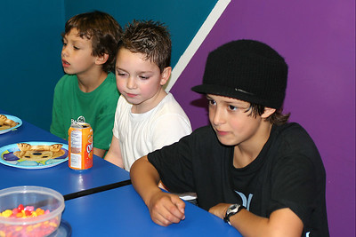 Ethan, Alec and Bryce getting ready for some cake during Sydney's 8th Birthday Party at the Ventura YMCA.