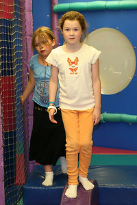Bailey and Julia in the jungle gym during Sydney's 8th Birthday Party at the Ventura YMCA.