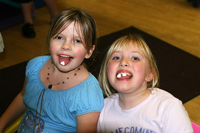 Bailey and Gwen enjoying some candy during Sydney's 8th Birthday Party at the Ventura YMCA.