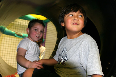 Alec and Austin at the top of the slide during Sydney's 8th Birthday Party at the Ventura YMCA.