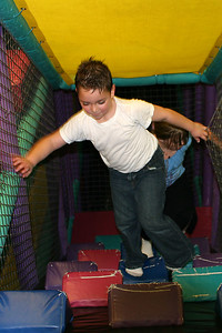 Alec climbing the jungle gym during Sydney's 8th Birthday Party at the Ventura YMCA.