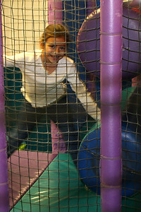 Alyssa hiding from the camera during Sydney's 8th Birthday Party at the Ventura YMCA.