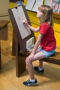Artist Sydney creating a masterpiece at the Getty Center.