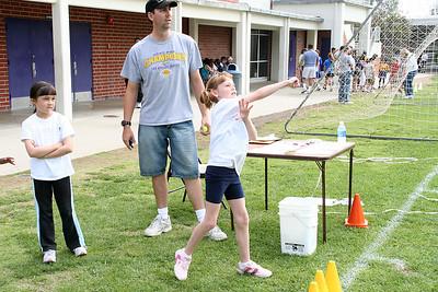 Sydney Kane throwing a tennis ball for distance. 2006 Lutheran elementary school track meet.