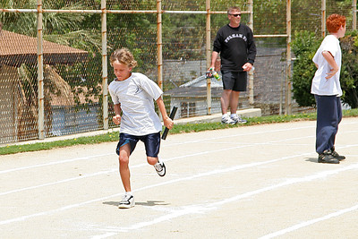 Justin and Ryan competing in the 400-meter relay. 2006 Lutheran elementary school track meet.