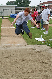 Ryan doing to the long jump. 2006 Lutheran elementary school track meet.