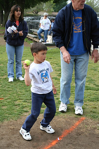 Eli Moore throwing a tennis ball for accuracy. 2006 Lutheran elementary school track meet.