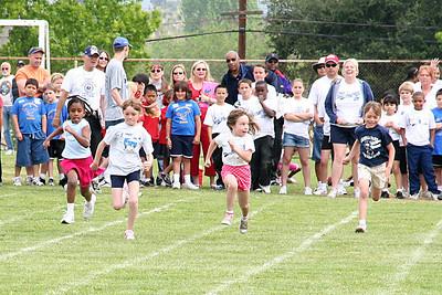 Sydney Kane running in the 50-meter dash. 2006 Lutheran elementary school track meet.