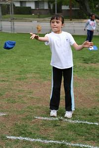 Sierra Moore competing in the bean bag toss. 2006 Lutheran elementary school track meet.