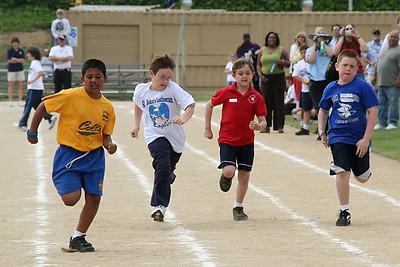 Eric running in the 75-meter dash. 2006 Lutheran elementary school track meet.
