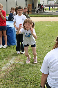 Sydney Kane competing in the standing long jump. 2006 Lutheran elementary school track meet.