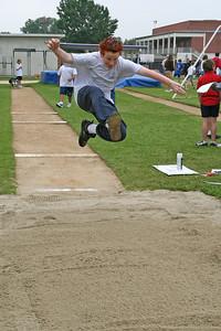 Ryan doing the long jump. 2006 Lutheran elementary school track meet.