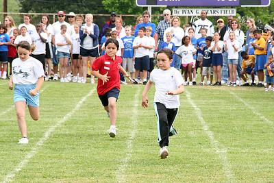 Sierra Moore running in the 50-meter dash. 2006 Lutheran elementary school track meet.
