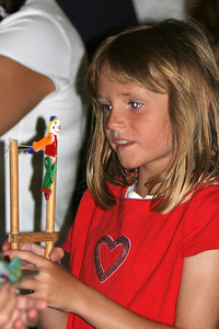 Sydney playing with one of the many wooden toys brought to the fair each year by Gene West. 2006 Ventura County Fair