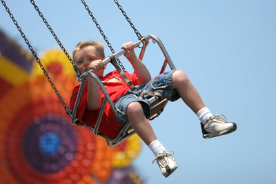 Christopher enjoying the chair-swing ride at the 2006 Ventura County Fair