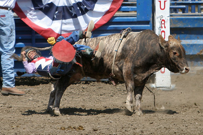 """A very young girl bull rider getting tossed from her """"bull"""" at the 2006 Ventura County Fair"""