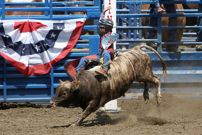 A very young girl bull rider trying to beat the buzzer at the 2006 Ventura County Fair