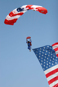 Skydiver bringing in the American flag to open the rodeo at the 2006 Ventura County Fair