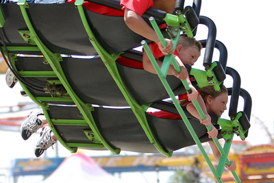Christopher and Sydney taking flight on one of the rides at the 2006 Ventura County Fair